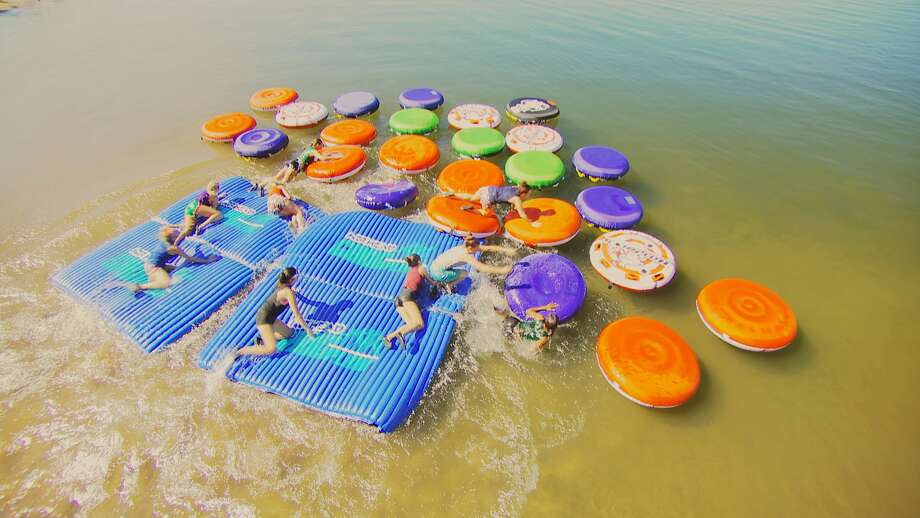 """FloatersIn the """"Floaters"""" challenge, contestants must make their way to a tube of a specific color without hitting the water first. Photo: CMT"""