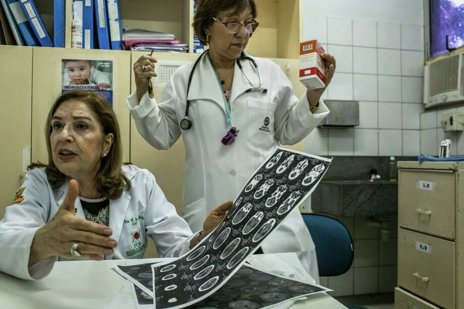 Dr. Angela Rocha shows a tomography result of a baby with microcephaly at the Oswaldo Cruz Hospital in Recife, Brazil, Jan. 29, 2016. Before last fall, medical reports of babies born with microcephaly were so rare in Brazil that only about 150 cases were registered each year in the entire country. Now Brazilian officials are now investigating thousands of them, and they say that the Zika virus is the cause. Photo: MAURICIO LIMA, New York Times / NYTNS