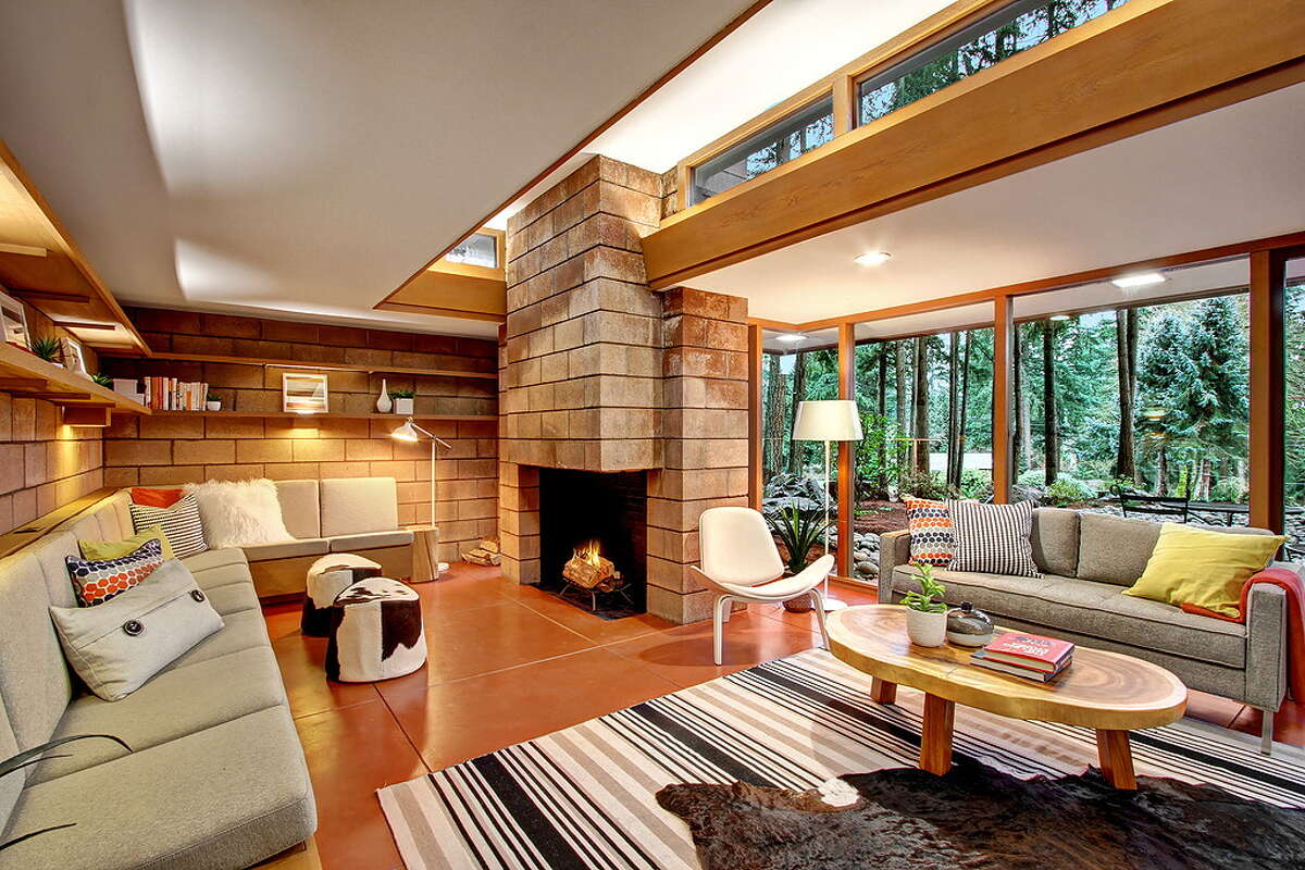 The home is built in the L-shaped Usonian style pioneered by Wright. It has a relatively flat roof, open floor plan and exposed brick walls.