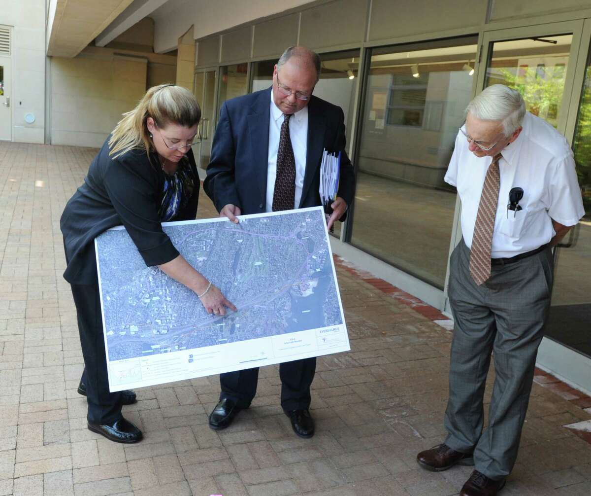 During a gathering at Greenwich Library, Jacqueline Gardell, left, of Eversource Energy, displays a map of Greenwich pointing out the proposed substation at 290 Railroad Ave., Greenwich, Conn., Tuesday, Sept. 1, 2015. Gardell was leading a siting council tour of the propsed substation. Eversource Energy has applied to build the structure on Railroad Avenue and use underground transmission lines to connect it to the existing substation in Cos Cob.
