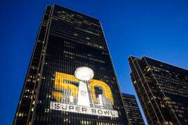 The Four Embarcadero Center building is lit up with a Super Bowl advertisement on opening night, in San Francisco, California on Saturday, January 30, 2016.