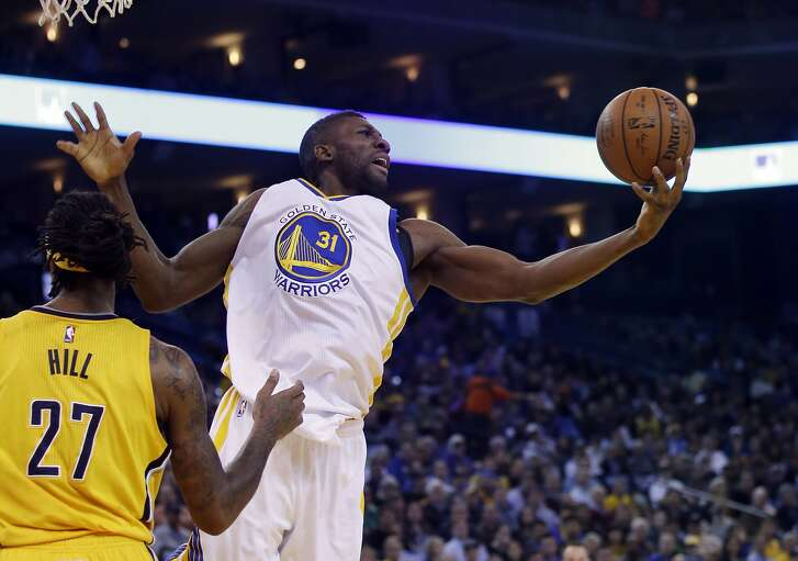 Golden State Warriors' Festus Ezeli (31) grabs a rebound against the Indiana Pacers during the first half Jan. 22 in Oakland.