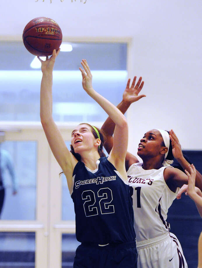 Defender Sydney Lowery (#31) of St. Luke's School, right, gets beat by Grace Passannante (#22), left, of Convent of the Sacred Heart as Passannante's scores on a layup during the girls high school basketball game between Convent of the Sacred Heart and St. Luke's School at Convent in Greenwich, Conn., Tuesday, Feb. 2, 2016. Photo: Bob Luckey Jr. / Hearst Connecticut Media / Greenwich Time