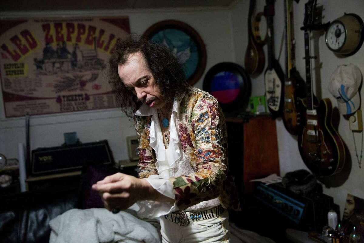 Hansen gets on his stage clothes at his home just blocks from Saturday night's venue, the Auburn Avenue Theater, on Jan. 30, 2016.