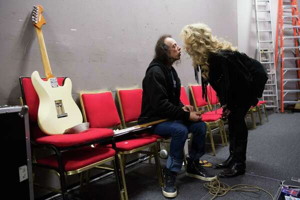 Ann Catherine Ice, Hansen's long-time girlfriend, gives him a kiss as he restrings guitars before a Hendrix tribute show at the Auburn Avenue Theater on Saturday, Jan. 30, 2016.