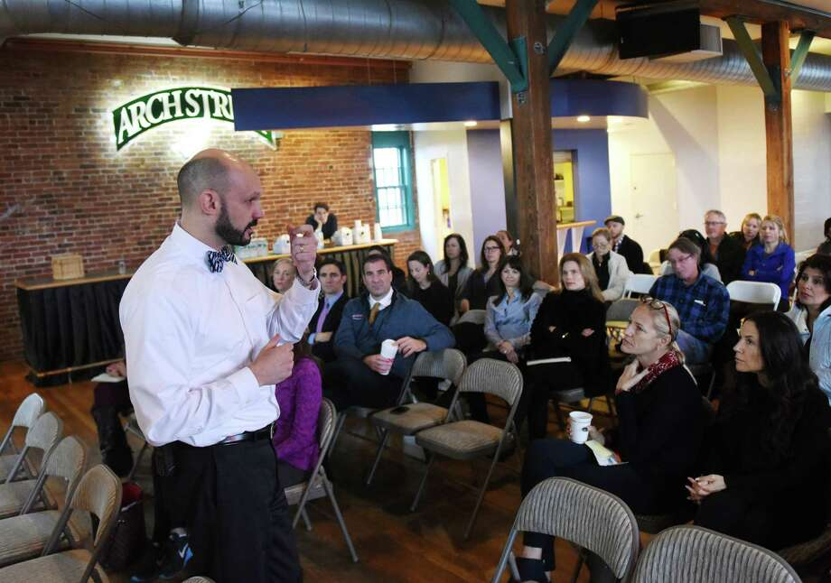 """Greenwich High School certified school psychologist Dr. Jeffrey DeTeso, Ph.D., speaks during the âÄúHow to Talk to Teens about Drinking and Drugs"""" discussion panel at the Arch Street Teen Center in Greenwich, Conn. Wednesday, Feb. 3, 2016. Dr. Frank Batolomeo, director of behavioral health services at the Southfield Center, Dr. Jeremy Barosky, director of addiction medicine at Greenwich Hospital, and Jeff DeTeso, certified school psychologist at Greenwich High School, gave insight on why some kids choose to participate in activities involving drugs and alcohol, how it can affect them and how to prevent it from happening. Photo: Tyler Sizemore / Hearst Connecticut Media / Greenwich Time"""