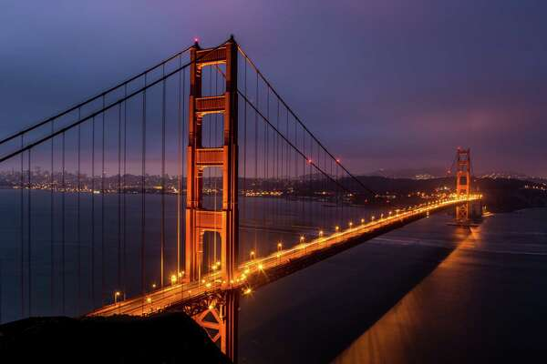 SAN FRANCISCO, CA - JUNE 23:  The Golden Gate Bridge is viewed from the Marin Headlands just before sunrise on June 23, 2015, in San Francisco, California. San Francisco continues to be a major global tourist destination and is experiencing a real estate and high-tech boom that some analysts believe is ready to bust.