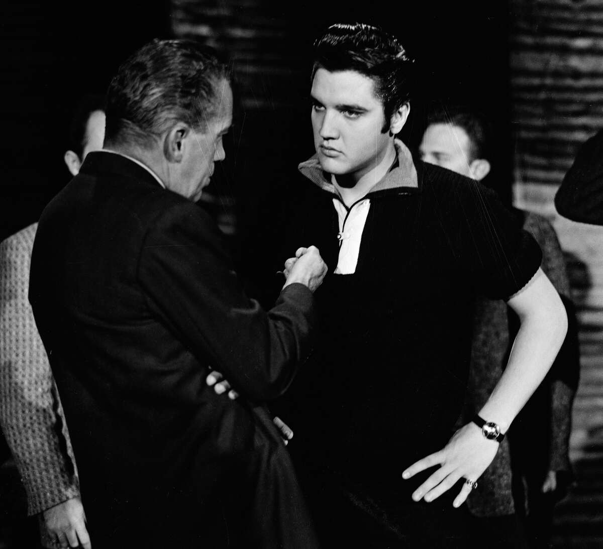 """""""The Ed Sullivan Show"""" really started the trend of families gathering around the TV on Sunday nights. Kids wanted to watch The Beatles or Elvis. Here, Elvis performs Sept. 9, 1956."""