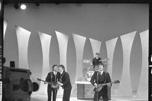 """""""The Ed Sullivan Show"""" really started the trend of families gathering around the TV on Sunday nights. Kids wanted to watch The Beatles or Elvis. Here The Beatles perform Feb. 9, 1964."""