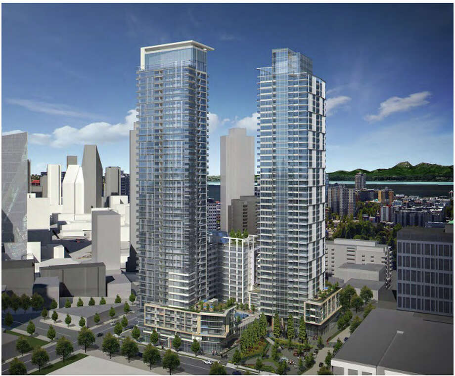 This rendering shows the two 41-story towers proposed for 1120 Denny Way. The project would include 1,197 residential units, 27,500 square feet of retail space, 32,000 square feet of public open space at ground level and 1,600 below-grade parking spaces. Photo: Courtesy Seattle Planning And Development / 2016