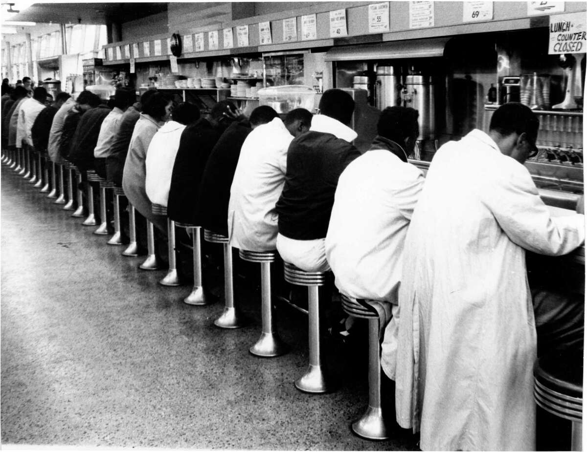 Houston in March 1960, before the city's lunch counters were integrated: Student demonstrators, members of the Progressive Youth Association, hold a sit-in protest at Weingarten's No. 26, 4110 Almeda.