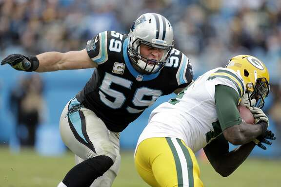 "FILE - In this Nov. 8, 2015, file photo, Carolina Panthers' Luke Kuechly (59) moves in to to tackle Green Bay Packers' James Starks (44) during the second half of an NFL football game in Charlotte, N.C. Off from the field, Panthers safety Roman Harper says Kuechly is ""the nicest guy you ever want to meet."" But when Kuechly hits the field, teammates say he changes into a person you wouldn't recognize, ferocious, fiery and competitive. (AP Photo/Bob Leverone, File)"