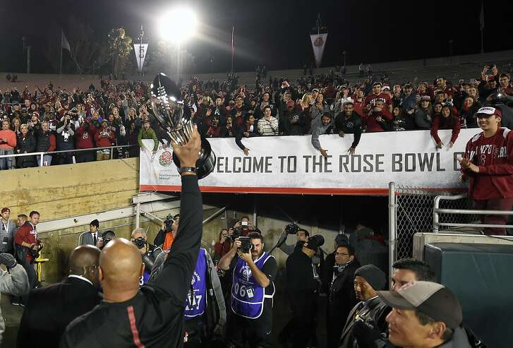 Stanford head coach David Shaw walks off the field after their win in the Rose Bowl NCAA college football game against Iowa, Friday, Jan. 1, 2016, in Pasadena, Calif. (AP Photo/Mark J. Terrill)