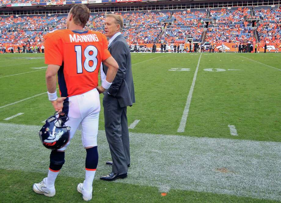 FILE - In this Sunday, Sept. 30, 2012, Denver Broncos' executive vice president of football operations John Elway, right, talks with quarterback Peyton Manning  during the fourth quarter of an NFL football game against the Oakland Raiders in Denver. Elway is one of the very few to say he won it all, then simply walked away. Now, Peyton Manning is trying to follow in Elway's footsteps, wearing the same Broncos uniform Elway wore when he walked off into the sunset nearly 20 years ago.  (AP Photo/David Zalubowski, File) ORG XMIT: NY162 Photo: David Zalubowski / AP