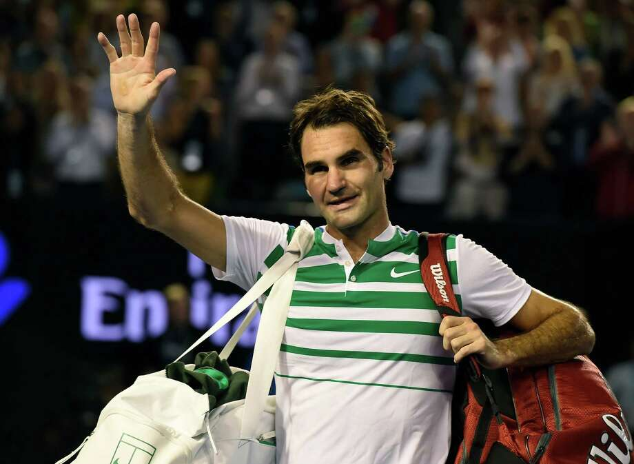 Roger Federer of Switzerland waves as he leaves Rod Laver Arena following his semifinal loss to Novak Djokovic of Serbia at the Australian Open tennis championships in Melbourne, Australia, Thursday, Jan. 28, 2016.(AP Photo/Andrew Brownbill) ORG XMIT: XMEL333 Photo: Andrew Brownbill / AP