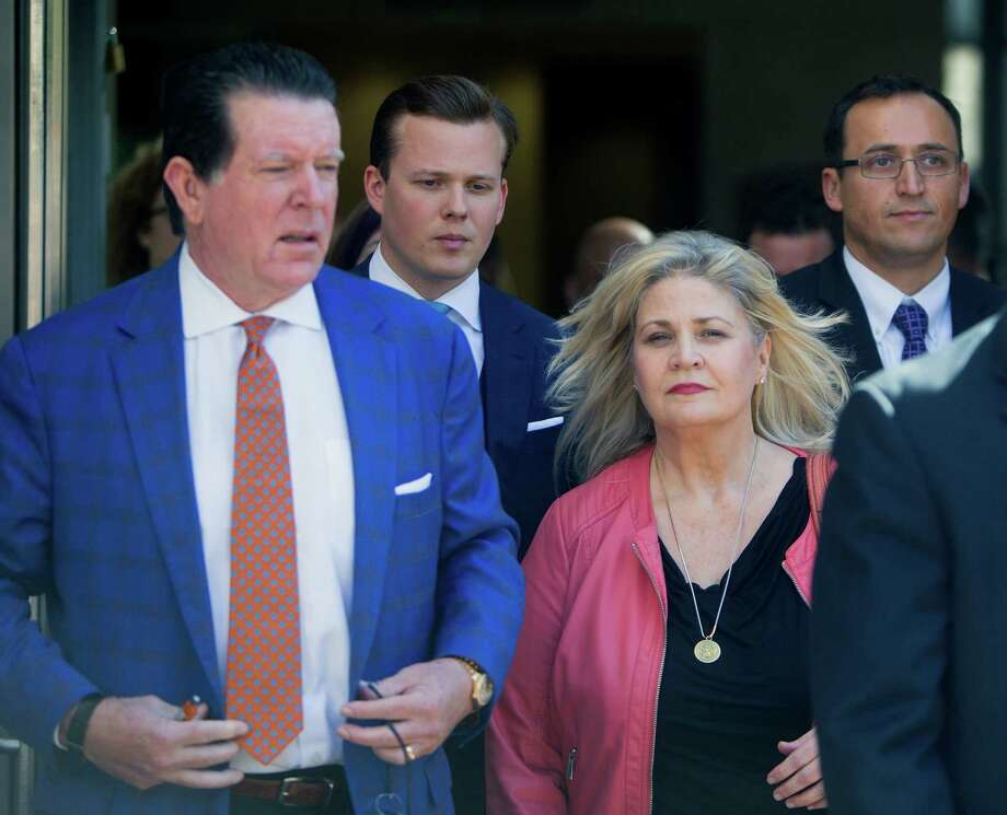 Surrounded by her attorneys, including Dan Cogdell, left, Sandra Merritt, center, leaves the 338th State District Court at the Harris County Criminal Courthouse, Wednesday, Feb. 3, 2016, in Houston. The pro-life activist was one of two people indicted by a Harris County grand jury on charges that they faked government documents in a video sting aimed at Planned Parenthood. (Cody Duty / Houston Chronicle) Photo: Cody Duty, Staff / Houston Chronicle / © 2015 Houston Chronicle