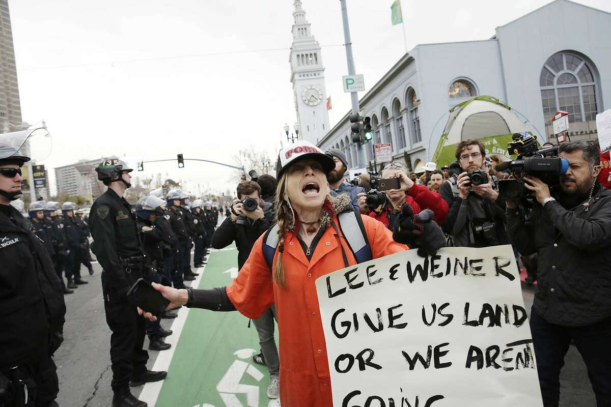 Lisa Gray Garcia calls out her thoughts on homelessness to others gathered along the Embarcadero during a protest on homelessness on Wednesday, February 3, 2016 in San Francisco.