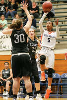 Gabby Connally, shooting over Emily Sims (left) and Caty Lorenz, scored 11 of her 41 points in overtime.