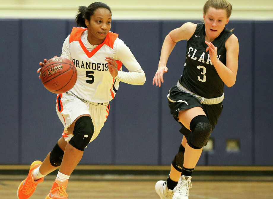 Brandeis's Gabby Connally (left) drives the ball up court against Clark's Kasey Rhone during the first half of their District 27-6A game at Taylor Field House on Feb. 3, 2016. Photo: Marvin Pfeiffer /San Antonio Express-News / Express-News 2016