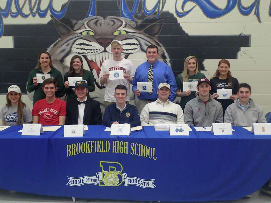 Brookfield High School celebrated its student-athletes who will be continuing their athletic pursuits in college at a signing-day ceremony in the school cafeteria Wednesday evening. Pictured are (front row, from left) Courtney Cacace, Albertus Magnus, lacrosse and soccer; Altin Celaj, Sacred Heart, soccer; Andrew Collins, Trinity College, lacrosse; Tommy Consalvo, Quinnipiac, cross country; Zach Delia, Massachusetts Maritime Academy, football; Bobby Drysdale, Harvard, football; and Jacob Fox, Susquehanna University, lacrosse; (back row, from left) Rachel Brown, Sienna College, swimming; Alison Bowers, Binghamton University, swimming; Jeff Ragatz, Gettysburg College, swimming; Nick Acquanita, Western Connecticut State, football; Morgan Grady, Skidmore College, softball; and Marisa Grisell, Southern Connecticut State, soccer. Photo: Rich Gregory / Rich Gregory / News-Times