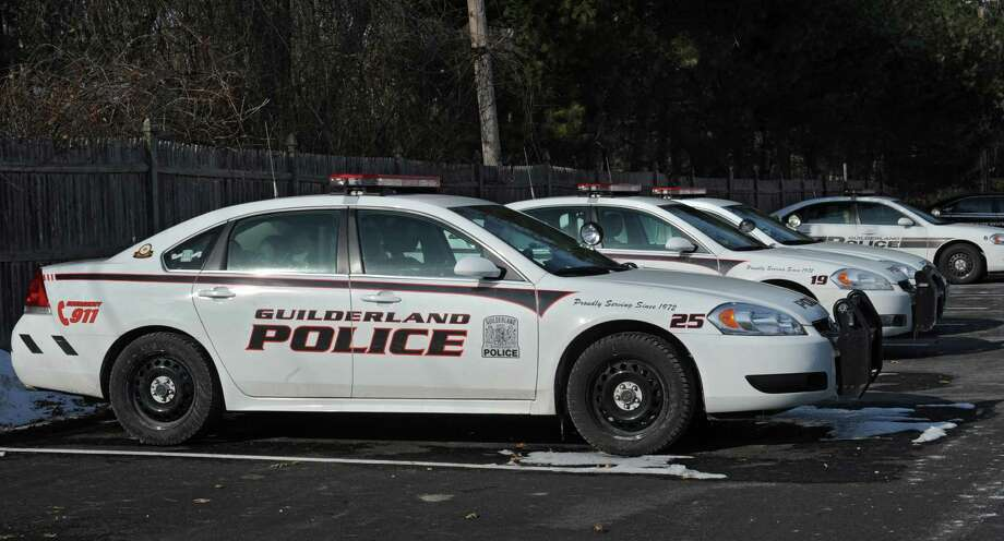 A fleet of Guilderland police patrol cars are parked next to the police station at Guilderland Town Hall on Friday, March 14, 2014 in Guilderland, N.Y.  (Lori Van Buren / Times Union) Photo: Lori Van Buren / 00026164A