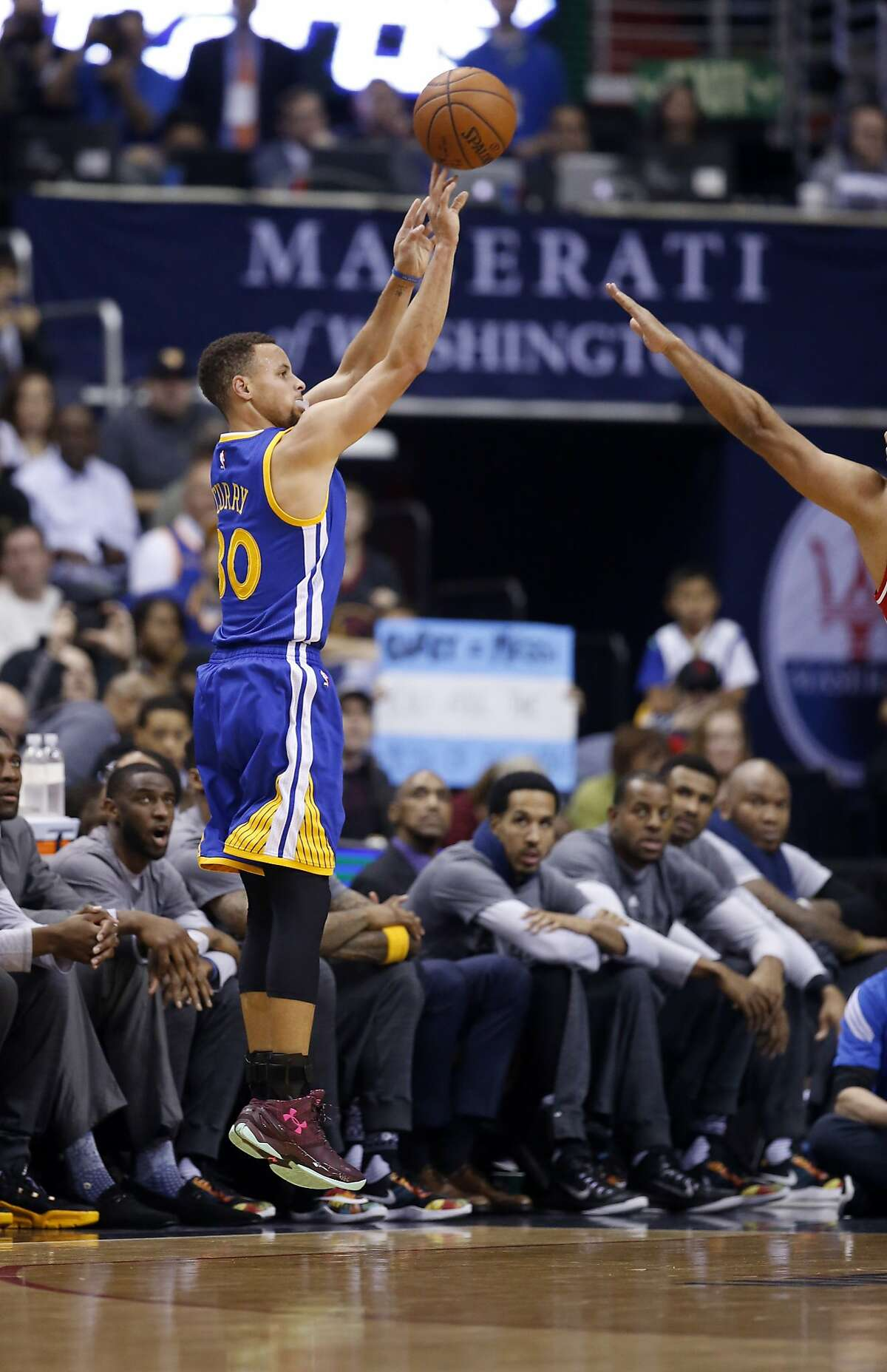 Golden State Warriors point guard Stephen Curry (30) shoots a three-pointer during the first half against the Washington Wizards on Wednesday at the Verizon Center.