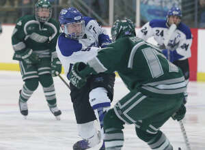 Saratoga's Elliott Hungerford takes a shot on goal past Shen defender Tom Relyea during Wednesday's varsity hockey matchup at Saratoga Springs Hockey Rink February 3, 2016. (Ed Burke/Special to The Times Union)