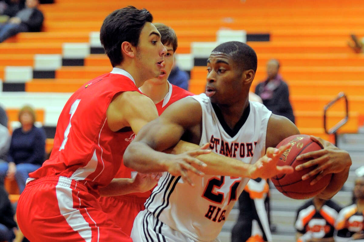Greenwich's Michael Gianopoulos (1) reaches in on Stamford's Steffan Harding (22) during the first half of Wednesday's game at Kuczo Gym.