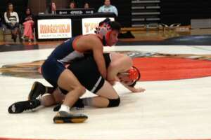 HIGH SCHOOL ROUNDUP: Danbury wrestlers pin Staples - Photo