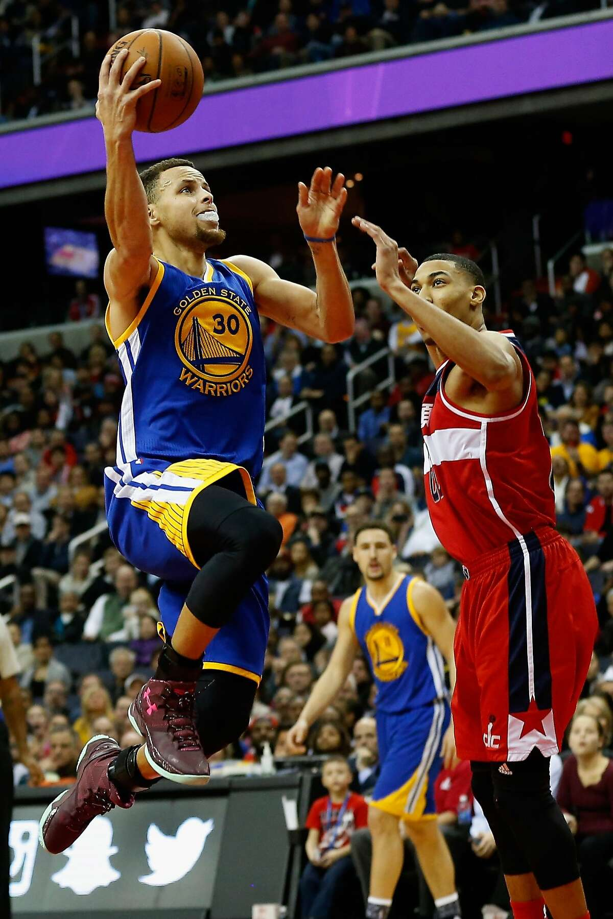 WASHINGTON, DC - FEBRUARY 03: Stephen Curry #30 of the Golden State Warriors puts up a shot in front of Otto Porter Jr. #22 of the Washington Wizards in the first half at Verizon Center on February 3, 2016 in Washington, DC. NOTE TO USER: User expressly acknowledges and agrees that, by downloading and or using this photograph, User is consenting to the terms and conditions of the Getty Images License Agreement. (Photo by Rob Carr/Getty Images)