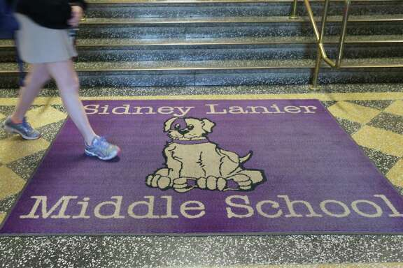 Sidney Lanier Middle School is home of the purple pups. Photos of a town hall meeting at Sidney Lanier Middle School in Houston to discuss changing the name on Wednesday, Feb. 3, 2016.