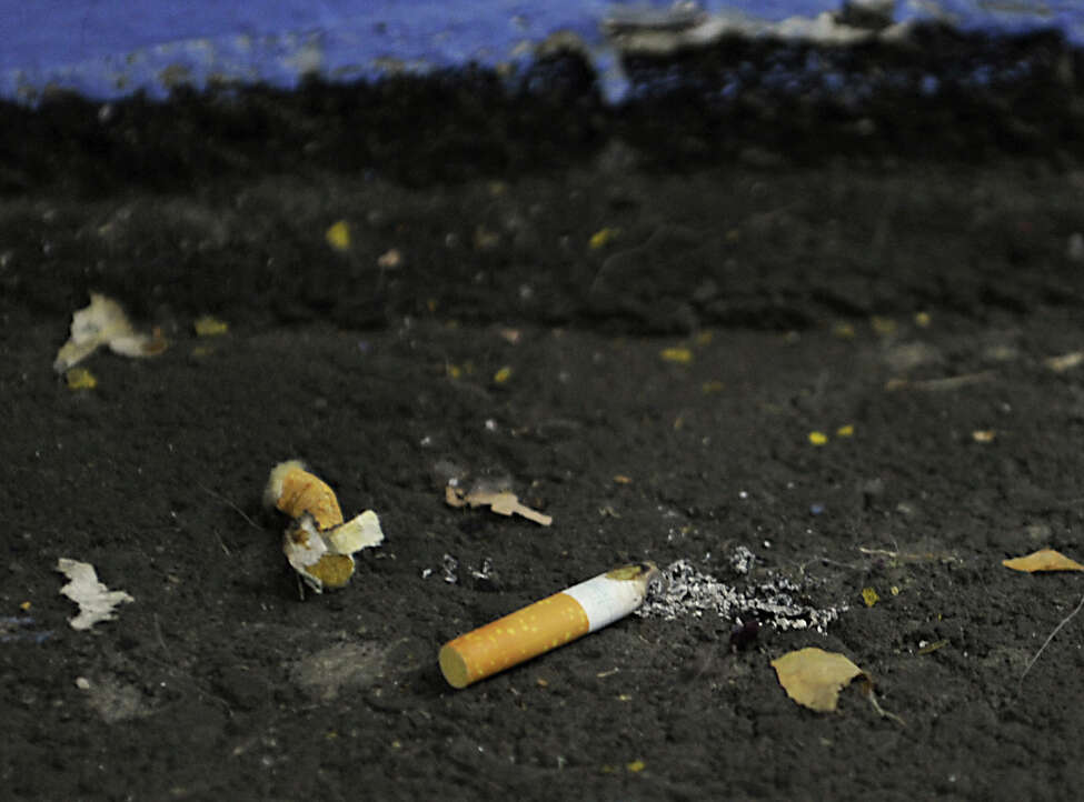 A couple of cigarette butts are seen by the elevators in the Empire State Plaza parking garage on Wednesday, Feb. 3, 2016 in Albany, N.Y. (Lori Van Buren / Times Union)