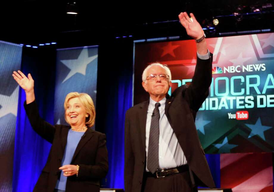 FILE - In this Jan. 17, 2016 photo, Democratic presidential candidates, Hillary Clinton and Sen. Bernie Sanders, I-Vt,  stand together before the start of the NBC, YouTube Democratic presidential debate at the Gaillard Center in Charleston, S.C.  The Democratic presidential campaigns of Hillary Clinton and Bernie Sanders reached an agreement in principle on Saturday to hold another presidential debate next week in New Hampshire and three more later this spring.  (AP Photo/Mic Smith) ORG XMIT: WX206 Photo: Mic Smith / FR2