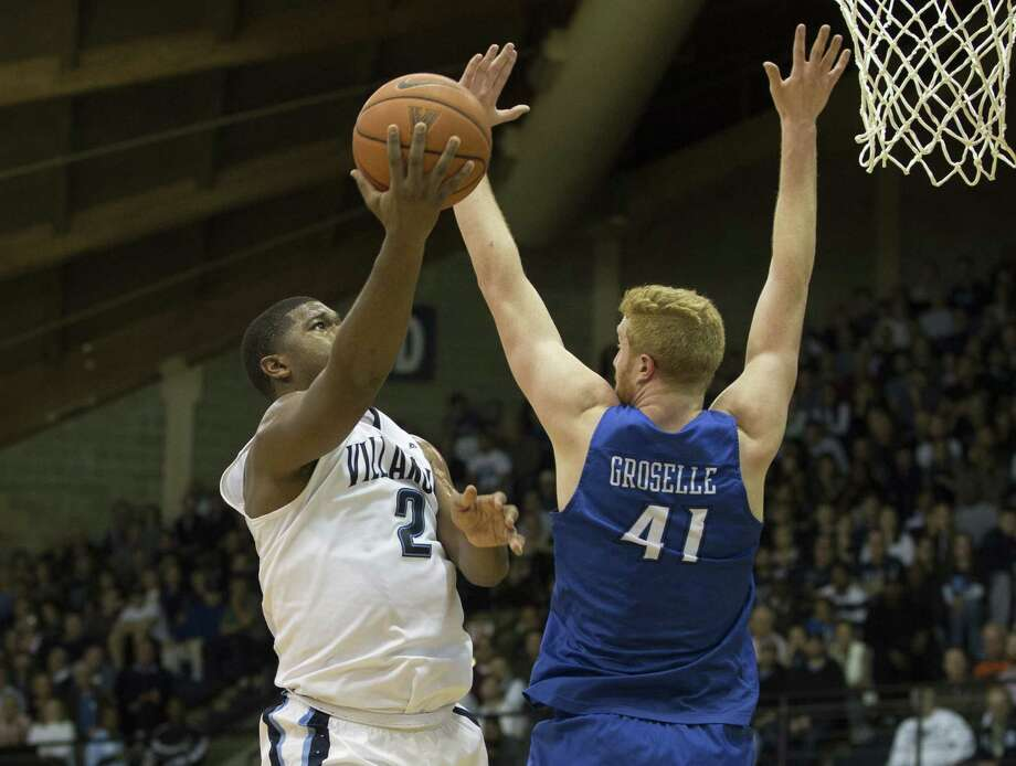 VILLANOVA, PA - FEBRUARY 3: Kris Jenkins #2 of the Villanova Wildcats takes a shot over Geoffrey Groselle #41 of the Creighton Bluejays on February 3, 2016 at the Pavilion in Villanova, Pennsylvania. (Photo by Mitchell Leff/Getty Images) ORG XMIT: 587466903 Photo: Mitchell Leff / 2016 Getty Images
