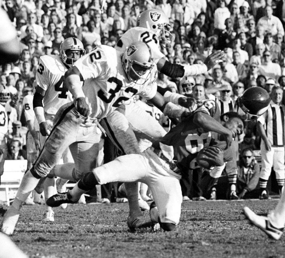 48. The Assassin strikes: Head-hunting safety Jack Tatum of Oakland delivered one of the most memorable hits in NFL history when he knocked off the helmet from Minnesota receiver Sammy White in Super Bowl XI. Today, the play would have gotten Tatum a penalty. Back then, he earned a place in NFL Films forever.