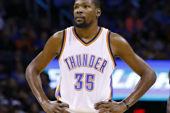 Oklahoma City Thunder forward Kevin Durant (35) watches as a teammate shoots free throws  during the second half of an NBA basketball game in Oklahoma City, Monday, Feb. 1, 2016. Oklahoma City won 114 -98. (AP Photo/Alonzo Adams)