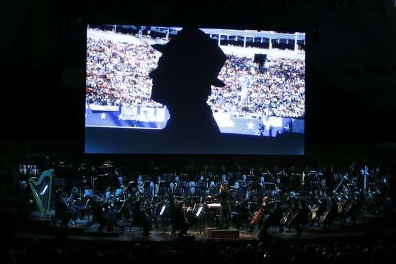 Dallas Cowboys' legendary coach Tom Landry appears on the screen as NFL Films and the San Francisco Symphony present A Concert of Champions at Davies Symphony Hall in San Francisco, Calif., on Wednesday, February 3, 2016.