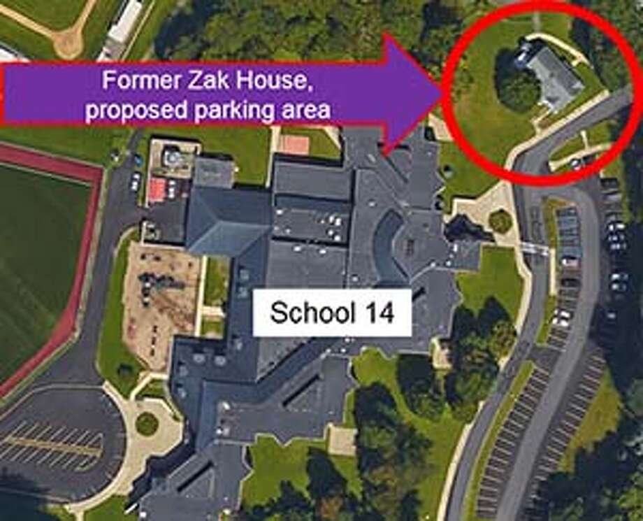 Voters will be asked to authorize the Troy school district to spend $124,100 to build a parking lot on the site of the former Zak House at 1728 Tibbits Ave. on Feb. 9, 2016. (Map provided)