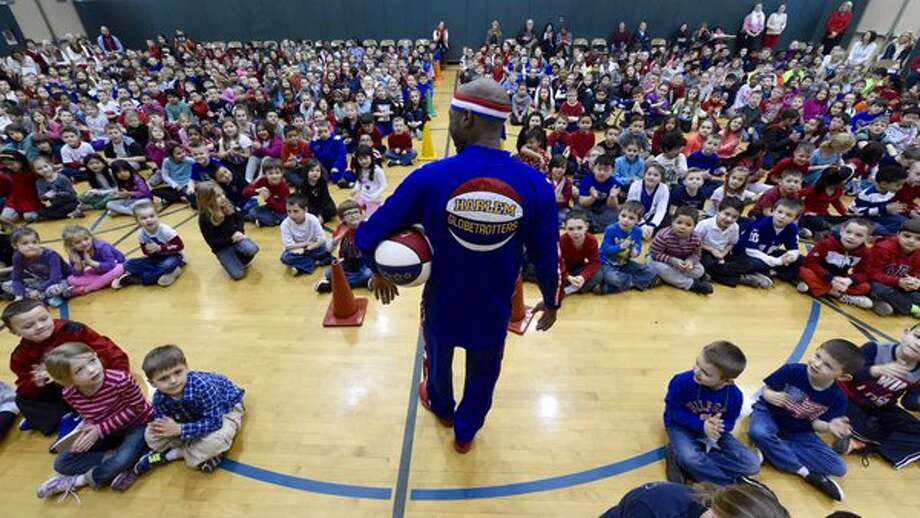 """Former Siena basketball star and Harlem Globetrotter Tay """"Firefly"""" Fisher talked about resisting bullying with students from Shenendehowa's Shatekon Elementary School on Thursday. (Skip Dickstein / Times Union)"""