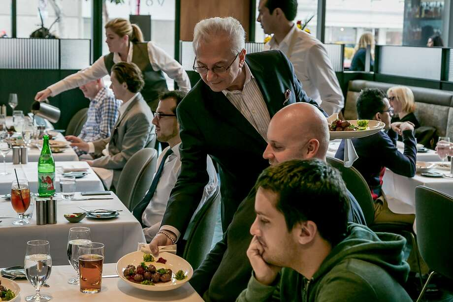 Umberto Gibin serves plates to diners for lunch at Volta. Photo: John Storey, Special To The Chronicle