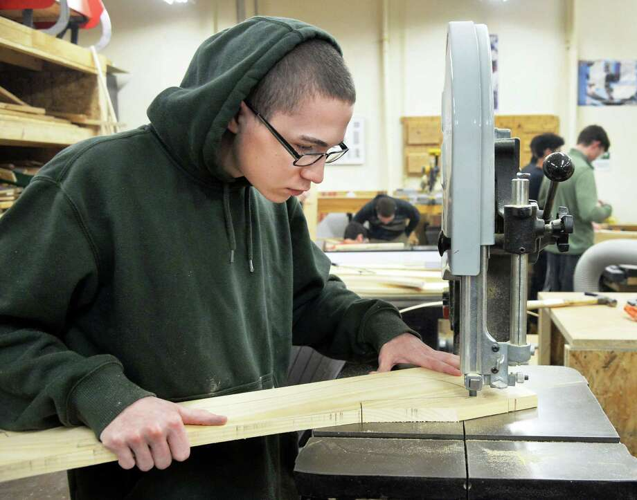 Capital Region BOCES CTE building trades student Cody Reyell of Rotterdam cuts out a part for an Adirondack chair during a SkillsUSA competition Thursday Feb. 4, 2016 in Colonie, NY.  (John Carl D'Annibale / Times Union) Photo: John Carl D'Annibale / 10035270A