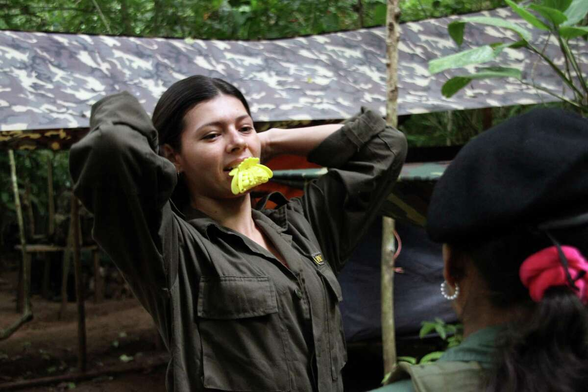 FARC women soldiers don't believe in marriage They cuddle with their 'partners' as they call them. Rebel leaders, who espouse gender equality, claim having women among their ranks helps prevent homesickness among the men. A Revolutionary Armed Forces of Colombia (FARC) guerrilla member -of a front of the Martin Caballero bloc of the FARC - EP-, arranges her hair. Peace talks between the Colombian government and the FARC will have a recess since December 21, 2012 until January 14, informed both delegations in Havana. AFP PHOTO / Dick Emanuelsson