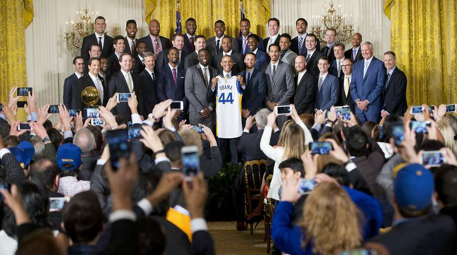 President Barack Obama holds up Golden State Warrior basketball jersey given to him by team members during a ceremony in the East Room of the White House in Washington, Thursday, Feb. 4, 2016, where he honored the 2015 NBA Champions. (AP Photo/Pablo Martinez Monsivais) Photo: Pablo Martinez Monsivais, Associated Press