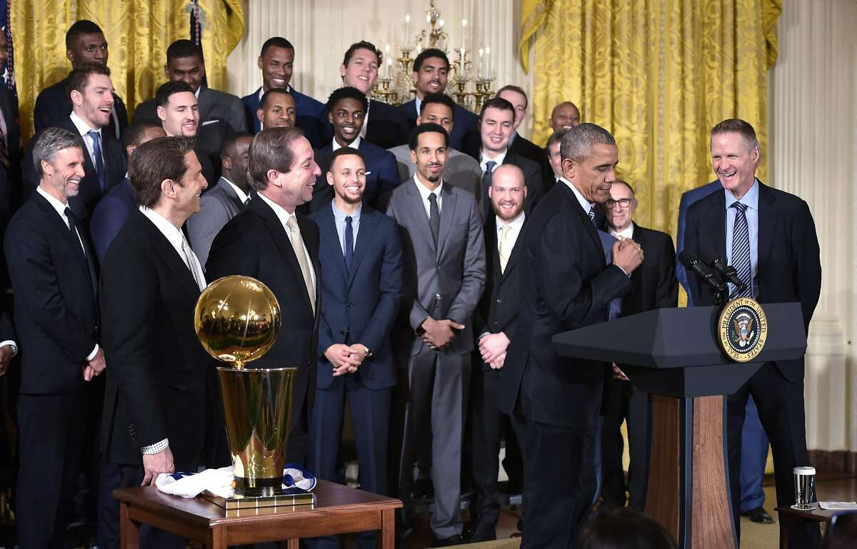 """US President Barack Obama mimics a player """"clowning"""" during an event honoring the 2015 NBA Champion Golden State Warriors in the East Room of the White House on February 4, 2015 in Washington, DC."""