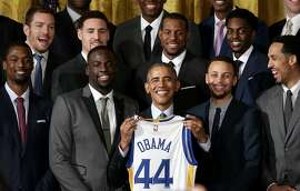 WASHINGTON, DC - FEBRUARY 04:  U.S. President Barack Obama holds a Golden State Warriors basketball jersey during an event with the team in the East Room on February 4, 2016 in Washington, DC. Obama welcomed the 2015 NBA Champion Golden State Warriors to the White House to congratulate the team on their championship season.  (Photo by Win McNamee/Getty Images)