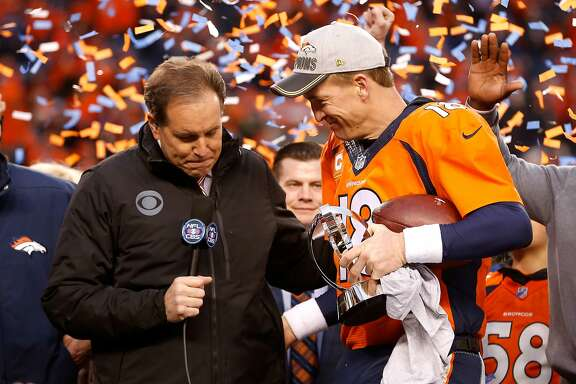 DENVER, CO - JANUARY 24:  Peyton Manning #18 of the Denver Broncos holds the Lamar Hunt Trophy while speaking to CBS TV personality Jim Nantz after the Broncos defeated the New England Patriots in the AFC Championship game at Sports Authority Field at Mile High on January 24, 2016 in Denver, Colorado. The Broncos defeated the Patriots 20-18. (Photo by Christian Petersen/Getty Images)