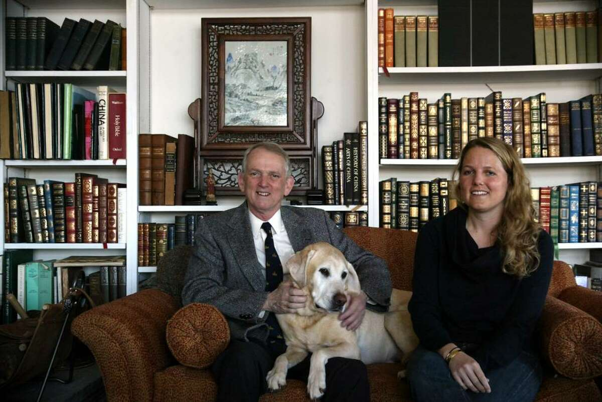 Rob Simmons, Republican candidate for the U.S. Senate, sits with his dog Bailey and his daughter Jane in the family home in Stonington, Conn.on Monday, March 8, 2010.