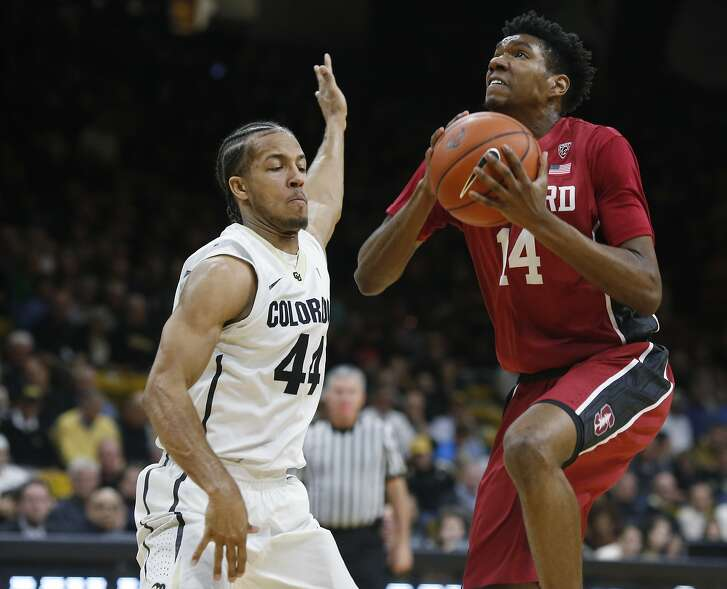 Stanford guard Marcus Sheffield, right, drives the lane for a basket as Colorado guard Josh Fortune defends during the first half of an NCAA college basketball game Wednesday, Jan. 27, 2016, in Boulder, Colo. (AP Photo/David Zalubowski)