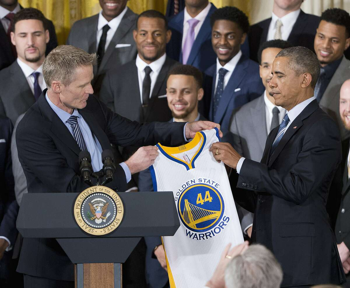 Golden State Warriors head basketball coach Steve Kerr presents President Barack Obama with a Golden State Warriors team basketball jersey during a ceremony in the East Room of the White House in Washington, Thursday, Feb. 4, 2016, where the president honored the 2015 NBA Champions. (AP Photo/Pablo Martinez Monsivais)