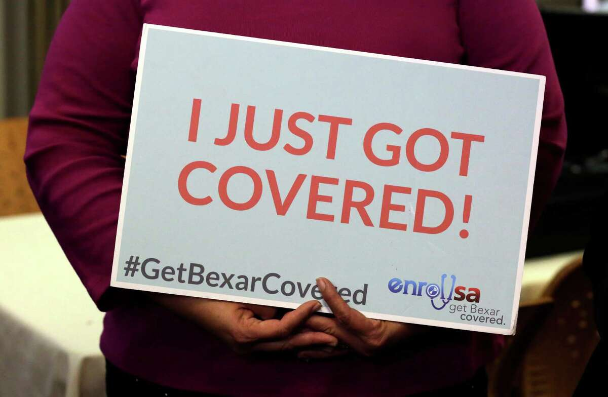 Magdalena Miranda has a message after she signed up for coverave last month during an affordable Care Act enrollment event at Southwest General Hospital in San Antonio. Texas had 100,000 more enrollees this year than last.